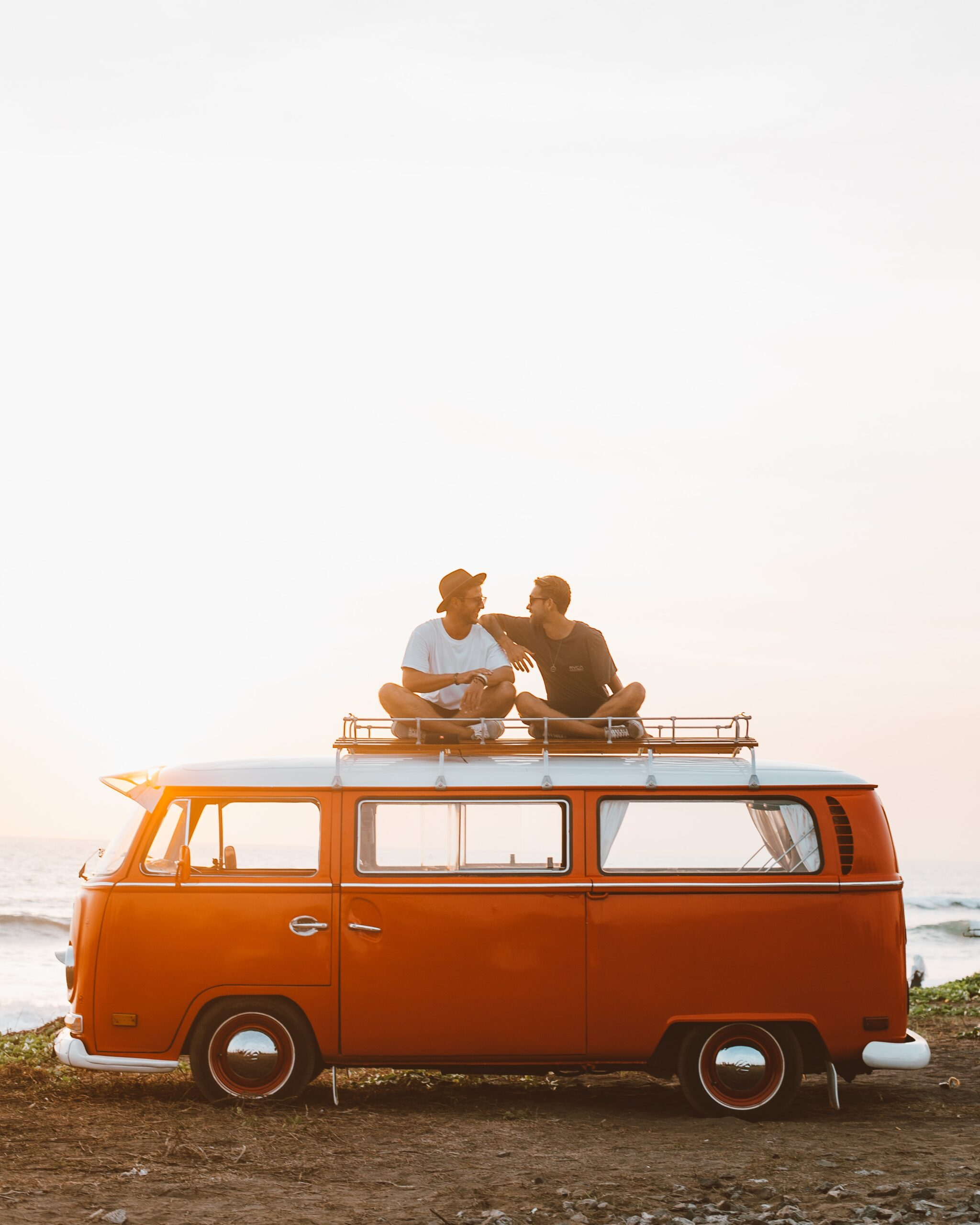 Two people on top of a van