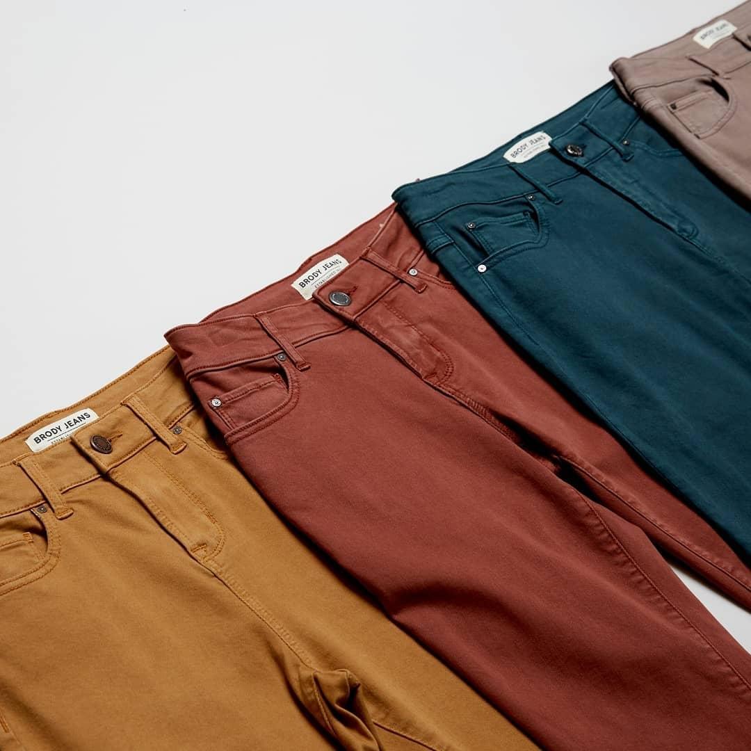 Row of fall coloured mens pants