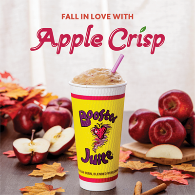 Booster Juice Apple Crisp smoothie in front of fall scene