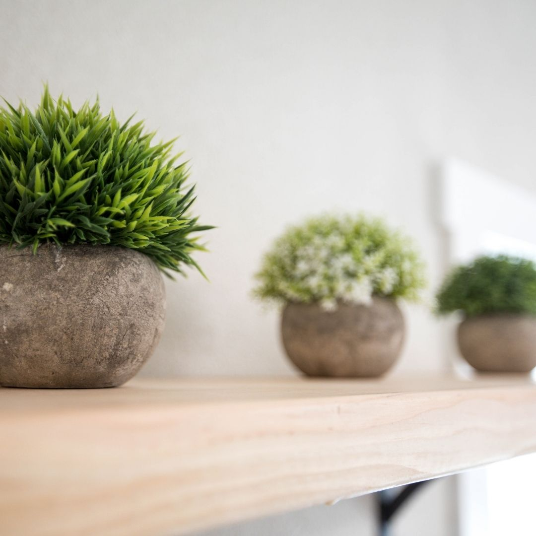 Faux plants in a circular vase