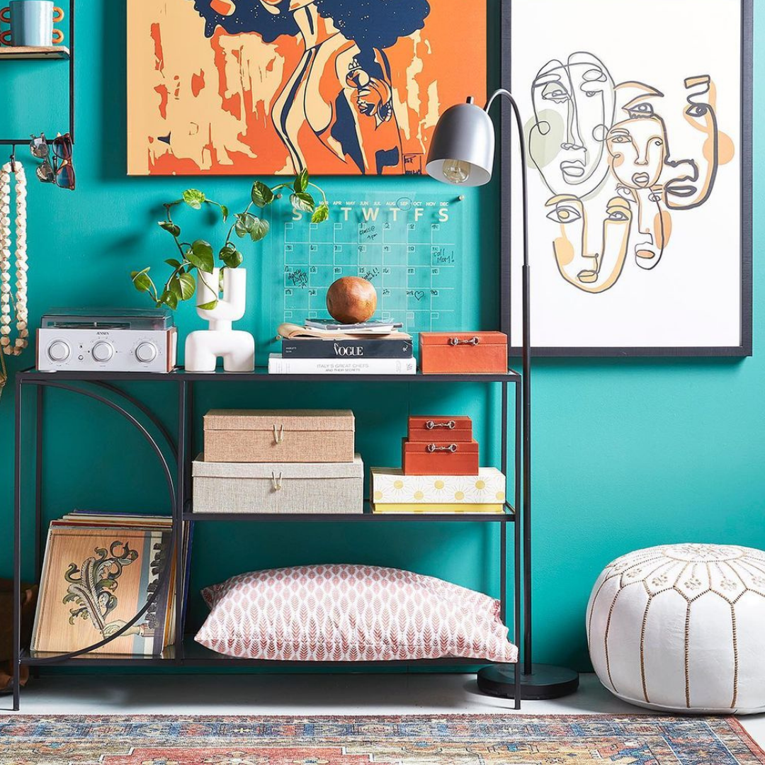 Standing lamp with a colourful backdrop and organized shelf