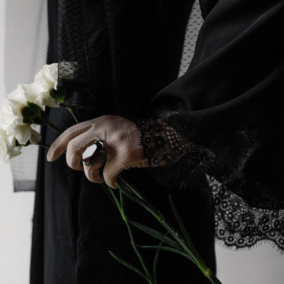 Black dress with lace and a black ring